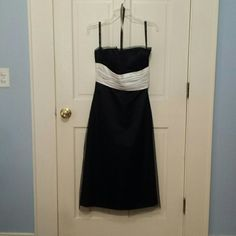 "Black Strapless Dress EUC Black Strapless Dress worn twice. Very figure flattering. Has a sheer over lay. I am 5' 4 "" and this hits mid calf. Would be very cute cut to knee length. Bill Levkoff Dresses Strapless"