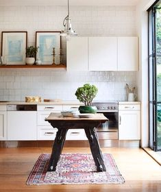Vintage rugs in bright modern kitchens  you just can't top it! Don't forget there won't be any new rugs listed this morning due to renovations but there are still lots of beauties available on the website! Photo found on @thedesignfiles