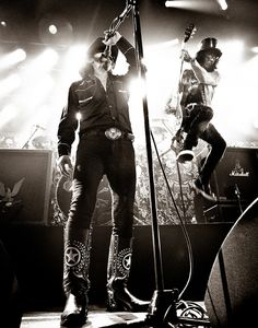 Lemmy and Slash...I love the juxtaposition of Lemmy steadfast and Slash up in the air!