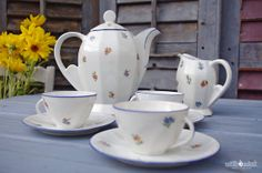 vintage french floral coffee tea set. Coffee pot, cream jug, three cups and saucers.