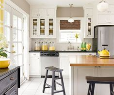 """By taking tips and tricks from the million dollar houses nearby, a newlywed couple completed a total kitchen makeover for less than $10,000. The couple's 1920s bungalow is fondly referred to as """"the quaint house."""" While the kitchen budget might have been somewhat limited, the new kitchen certainly doesn't lack style or function."""