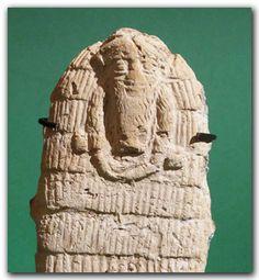 Mesopotamian Terracotta Plaque, the Deity Enki, c. 2000 B.C., with long beard wearing a tiered robe, flow of water flowing from the two sides of his face.  He was the god of subterranean fresh water and was associated with wisdom, magic and with the arts and crafts of civilisation.