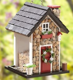 They no longer carry this, but maybe we could copy the idea? Stone Bird House Feeder