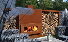 Landscaping And Outdoor Building , Popular Outdoor Fireplace Design : Copper Modern Outdoor Fireplace Design With Wood Storage