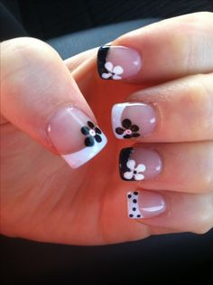 I love the idea, but I don't like every other nail different. Black and White French Tips with Contrasting Flowers!