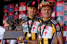 Christoph Sauser and the late Burry Stander of Team Songo-Specialized at prize-giving during the final stage (stage of the 2011 Absa Cape Epic Mountain Bike stage Adidas, Mountain Biking, Gentleman, Champion, Abs, Baseball Cards, Bikers, Sports, Stage