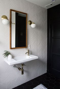 Black + White. The herringbone pattern/layout adds texture to a bathroom.