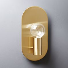 Shop plate brass wall sconce.   Designed by Mermelada Estudio, this sconce is the picture of pure simplicity.