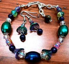 """Color Craze Bracelet $12.00 Free Shipping! Bracelet-8""""/9"""" with extender. Silver hook clasp. Deep purple centerpiece with silver bead toppers, iridescent lucite beads, tie dye glass flowers, gorgeous green faceted lucite and paint splashed tie dye glass beads.."""