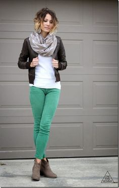 dark brown faux leather jacket + tan and white printed scarf + white sweater + mint/green pants + tan booties