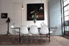 Dining room.  Wood floors, vitra chairs, french glass lights.  SHOOTFACTORY: london apartments / Trafalgar, londone9