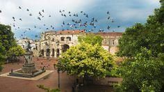 Doves flying over main square with columbus statue, santo domingo, dominican republic (photo