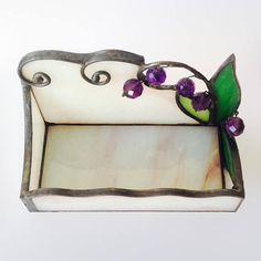 The Amethyst stained glass business card holder was designed and made with white and green opaque glass and using ultraviolet amethyst crystals on the glass art. This business card holder can be a wonderful office decor on your office desk as part of your office decoration or a gorgeous