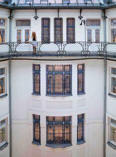 The beautiful court yard balcony at Four Seasons Hotel Gresham Palace. Featuring stunning hand painted glass windows, and iron railings.