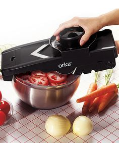 Slicing and grating is simple nonslip base, integrated food pusher includes a fine blade for grating hard cheeses, chocolates and nuts; a waffle-cut blade; a grating blade for veggies asoft cheeses; and two julienne blades, all which store beneath.Includes slicer, v-blade, fine blade,