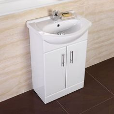 This compact vanity unit is perfect for a small cloakroom suite ...