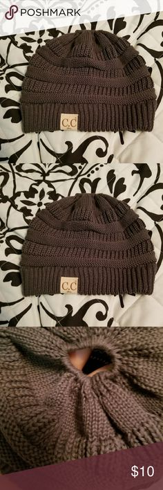 C.C. hat beanie Beanie with hole for bun! Worn one time I bought it and decided the color was not what I wanted and didn't match the outfit. C.C Accessories Hats