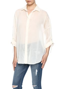 Cream semi sheer blouse with long roll tab sleeves and a button front closure.  Size 36= Small. Size 38= medium size 40= large.  The Luchy Chemise by IRO. Clothing - Tops - Long Sleeve Clothing - Tops - Button Down Oklahoma