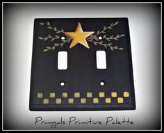 This is a double outlet cover that I have painted black then added an antique gold star with leaves and berries. A matching gold checkerboard was added