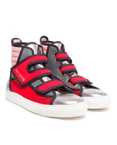 RAF SIMONS | Panelled Canvas and Leather Hi-Tops When wearing sneakers such as these it is best to make sure it is the shoes that are doing the talking and not another article of clothing you might be wearing. These sneakers have a lot going on and another flashy piece can contrast them in a way not befitting of it's own luster. Colors like black and white can compliment these and bring forth more positive attention towards them.
