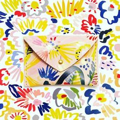 <Vibrant Illustrations Add a Painterly Touch to the Things You Carry Every Day Hand-painted leather bag by Lillian Farag Painted Bags, Hand Painted, Painted Canvas, Textiles, Textile Prints, Textile Design, Floral Clutches, Painting Leather, Embroidery Hoop Art