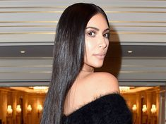 Kim Kardashian's hair is so sleek that it looks like a wig here's the surprising product she swears by
