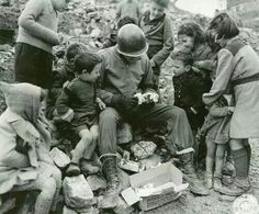 American soldier sharing his christmas package with children in Italy