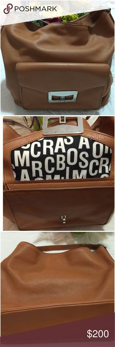 Marc by Marc Jacobs Hardly used. Cute big soft leather brown bag. Front pocket open up (2nd pic). Look at 4th to see how big inside the bag. One zipper pocket & 2 pockets inside of big. Handle of bag is short Marc by Marc Jacobs Bags Satchels