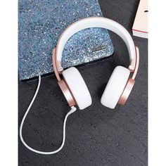 Urbanista Seattle Headphones in Rose Gold ($89) ❤ liked on Polyvore featuring accessories, tech accessories, pink, rose gold headphones, portable headphones, urbanista and pink headphones
