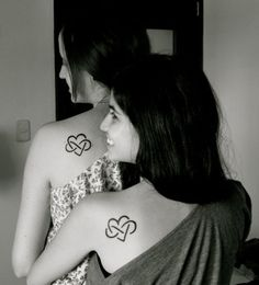 The heart in infinity symbol represents the eternal love of the two sisters.
