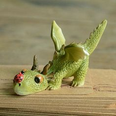 Fairy Garden Dragon and the Ladybug. https://teeliesfairygardenstore.com/ . . . This playful and kind dragon wants to play with the ladybug. Bring this fairy garden dragon and the ladybug to play with the fairies in your garden today! #Dragons