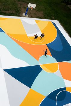 """Playground"" by GUE in Alessandria, Italy. This installation carries on GUE his research on shapes and colors. He decided to use the colors that can be found in the color palette of the basketball courts, combining them to give the possibility of an easy reading of the game's schemes. The artwork is a tribute to Carlo Carrà, futurist artist, who was born in Alessandria. Pictures by Ugo Galassi. https://www.facebook.com/gummygue 