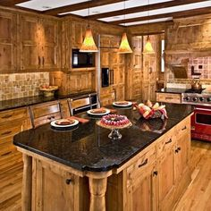 Kitchen Cabinets Knotty Pine rustic kitchen - the knotty alder cabinets and natural stone floor