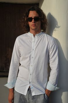 Indus White cotton shirt with a nehru collar and contrast cuffs. Ibiza shoot. Santa Gertrudis