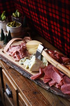 A meat and cheese board piled high is a must for any lumberjack party!