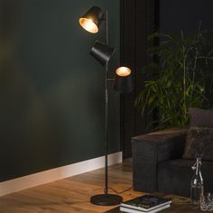 This industrial floor lamp has three light sources, is made of metal and is finished with a charcoal touch. The light sources distributes the light in a beautiful way through the room, creating a great ambiance. Retro Floor Lamps, Wooden Floor Lamps, Industrial Floor Lamps, Industrial Ceiling Lights, Black Floor Lamp, Drop Lights, Wall Lights, Desk Lamp, Table Lamp