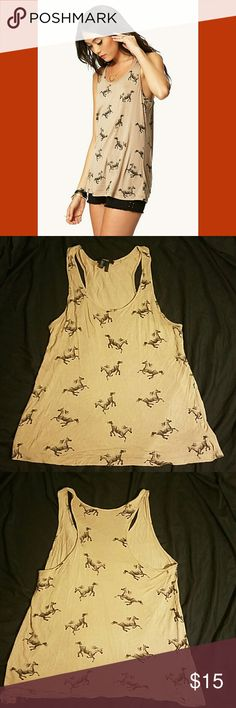 """Tan Horse Racerback Tank This tank has a fun horse print and a racerback detail on the back.  Shoulder to hem 27.5"""" Lightly worn, great condition, fits true to size Forever 21 Tops Tank Tops"""