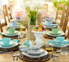 What a pretty Easter table!!  Love the white tulips wrapped in burlap vase!