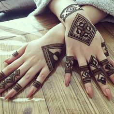 Your Comments About This Hand Henna/Mehndi Design!Fascinating new year mehndi designs for hands and arms are just perfect for enhancing your beautiful appearance and personality. Hardly, there would be any woman who has not applied mehndi on her and Henna Hand Designs, Eid Mehndi Designs, Mehndi Designs Finger, Traditional Mehndi Designs, Stylish Mehndi Designs, Mehndi Designs For Fingers, Mehndi Patterns, Mehndi Design Pictures, Latest Mehndi Designs