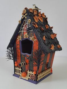 This halloween ornament was made by painting and decorating a wooden birdhouse. The haunted miniature house was painted orange and black. Diy Halloween Village, Halloween Window, Halloween Ornaments, Halloween Haunted Houses, Outdoor Halloween, Diy Halloween Decorations, Halloween House, Halloween Crafts, Birdhouse Craft