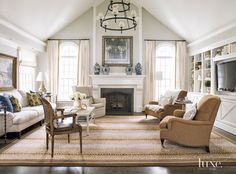 Living room. Cathedral ceiling chandelier. Living room. #livingroom #CathedralCeiling #Chandelier Beth Gularson. Helen Norman Photography.