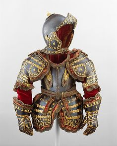 "Armor of Infante Luis, Prince of Asturias, Signature probably refers to Jean Drouart, dated 1712, French (Paris), steel, gilt brass, silk, cotton, metallic yarn and paper. ""Possibly the last royal armor made in Europe, this is believed to have been presented to 5-yr-old Infante Luis (1707–1724), prince of Asturias, by his great-grandfather Louis XIV of France (1638–1715, reigned from 1643). Luis was the first Spanish-born Bourbon heir to the throne of Spain and ruled briefly as Luis I in 1724."""