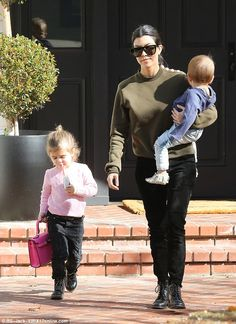 Matching! Both Kourtney and her daughter sported black trousers and ankle boots...