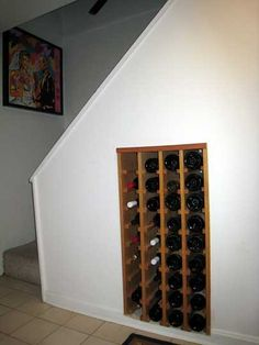 Maybe put lower wine storage in like this to take advantage of space next to mini bar recessed under stairs?