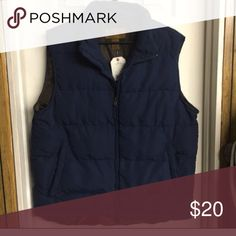 Navy blue and brown hunting vest This beat is new with tags on it. Sure to keep you warm Jackets & Coats Vests