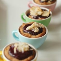 Mini almond cookie cups filled with homemade berry curd.