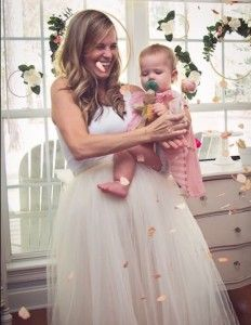 Birthday girl being showered with flower petals from a Floral 1st Birthday Party via Kara's Party Ideas | KarasPartyIdeas.com (4)
