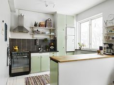 What a happy, bright and colorful kitchen (love this color!)! Makes me smile!