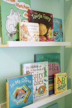 Girly Nest Nursery Books - also in love with these shelves (from Ikea) such a nice way to add colour to your room and encourage a love of reading.