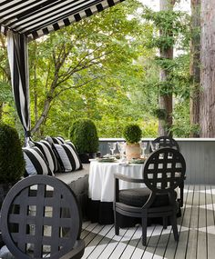 Elegant black-and-white stripes. The classic grid pattern on the chairs flows well with the striped Sunbrella fabric and the floor's diamond design